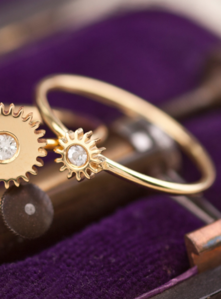 Small Gold Cog Ring With White Sapphire