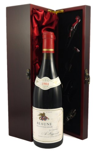 1984 Beaune A. Ligeret vintage wine presented in a silk lined wooden box with four wine accessories,